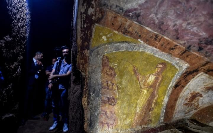 Journalists are given a tour of the tunnels and decorated crypts of the St Domitilla Catacombs in Rome.