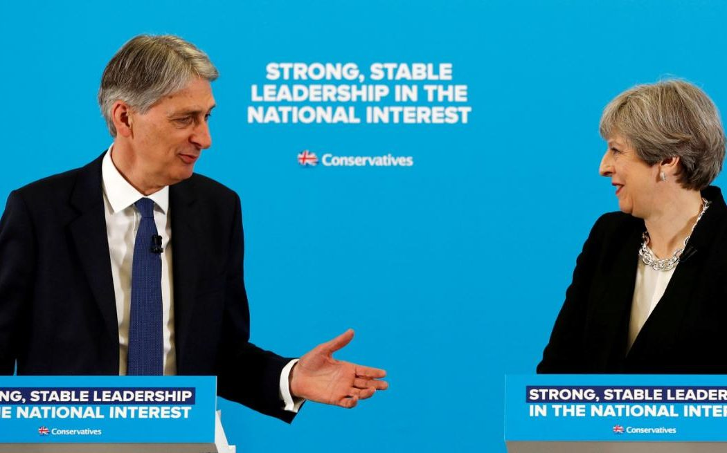 At loggerheads: Philip Hammond is fighting Theresa May for a softer Brexit