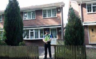 Police outside Darren Osborne's former home in Cardiff