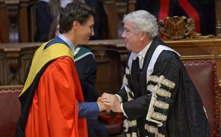 Canada's Prime Minister Justin Trudeau (L) taking part in a ceremony with Edinburgh University principal Timothy O'Shea to be awarded an honorary degree at the University of Edinburgh