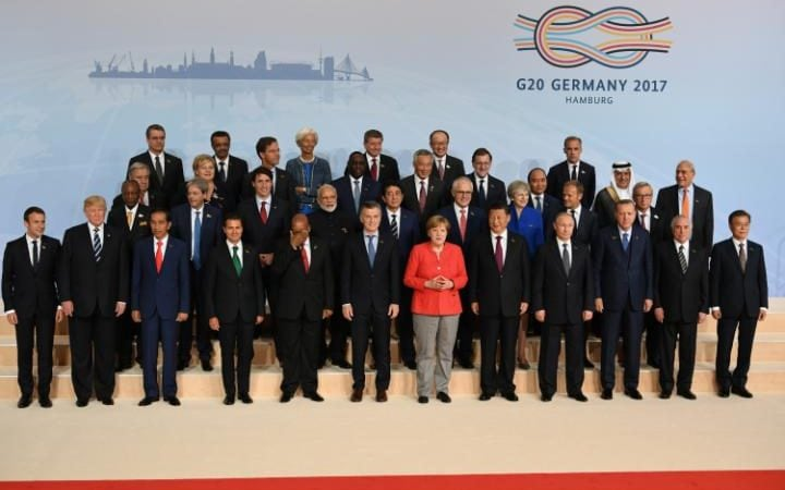 There was a noticeable gap on the top row as G20 leaders posed for their traditional family photo