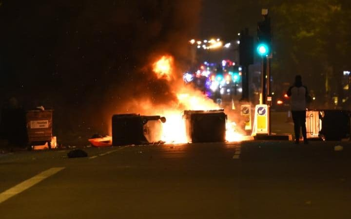 Makeshift road blocks in fire at a protest in Kingsland Road in east London