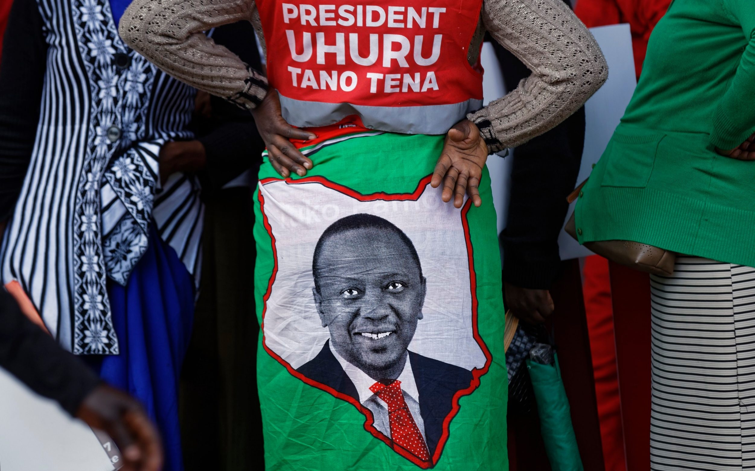 A supporter wears a cloth wrap showing Kenya's incumbent President Uhuru Kenyatta