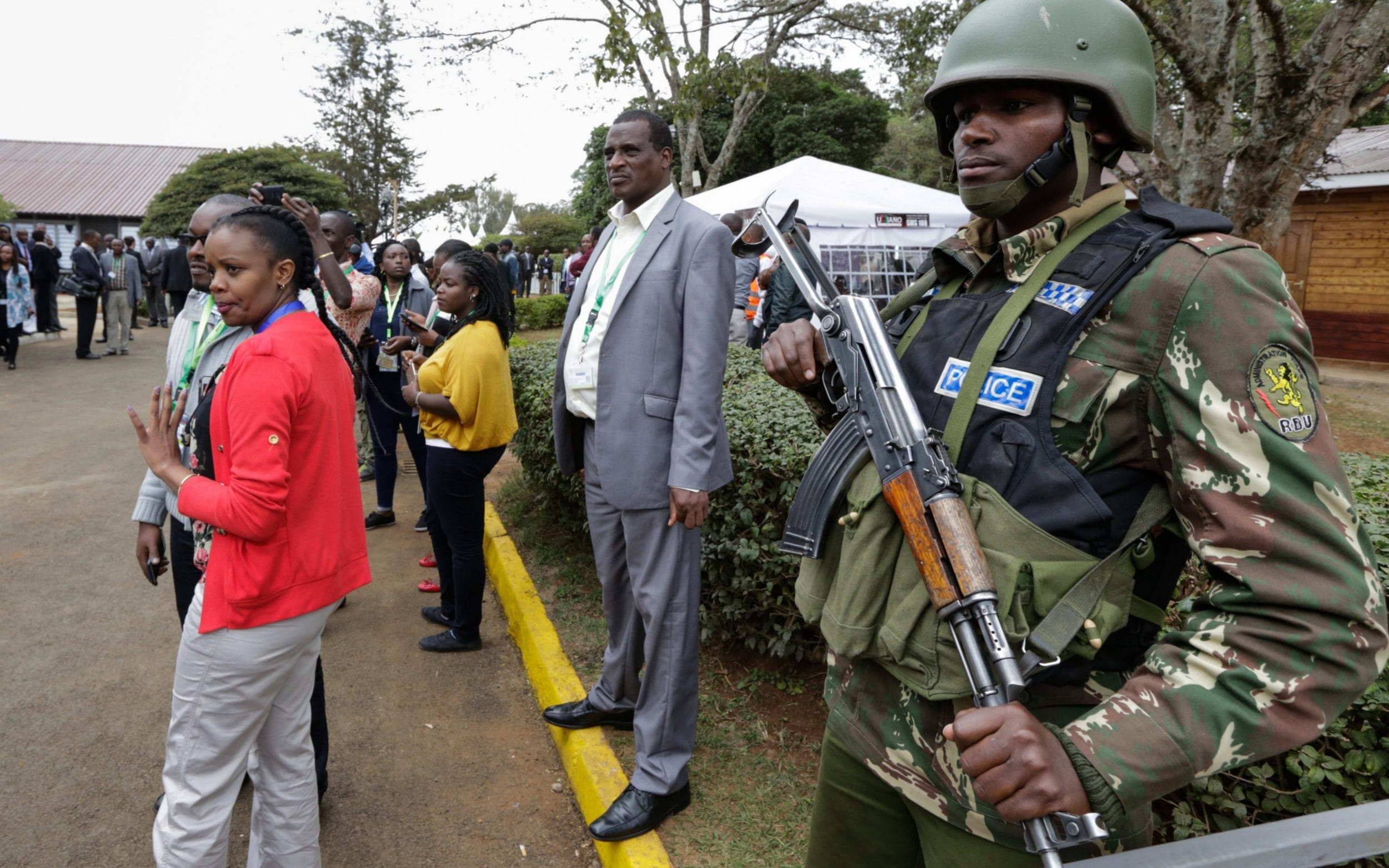 A police officer stands guard at the national tallying centre as Kenyans await the announcement on Friday