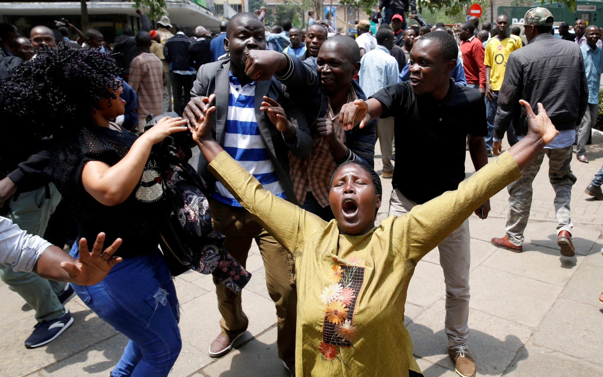 Supporters of opposition leader Raila Odinga cheer outside court
