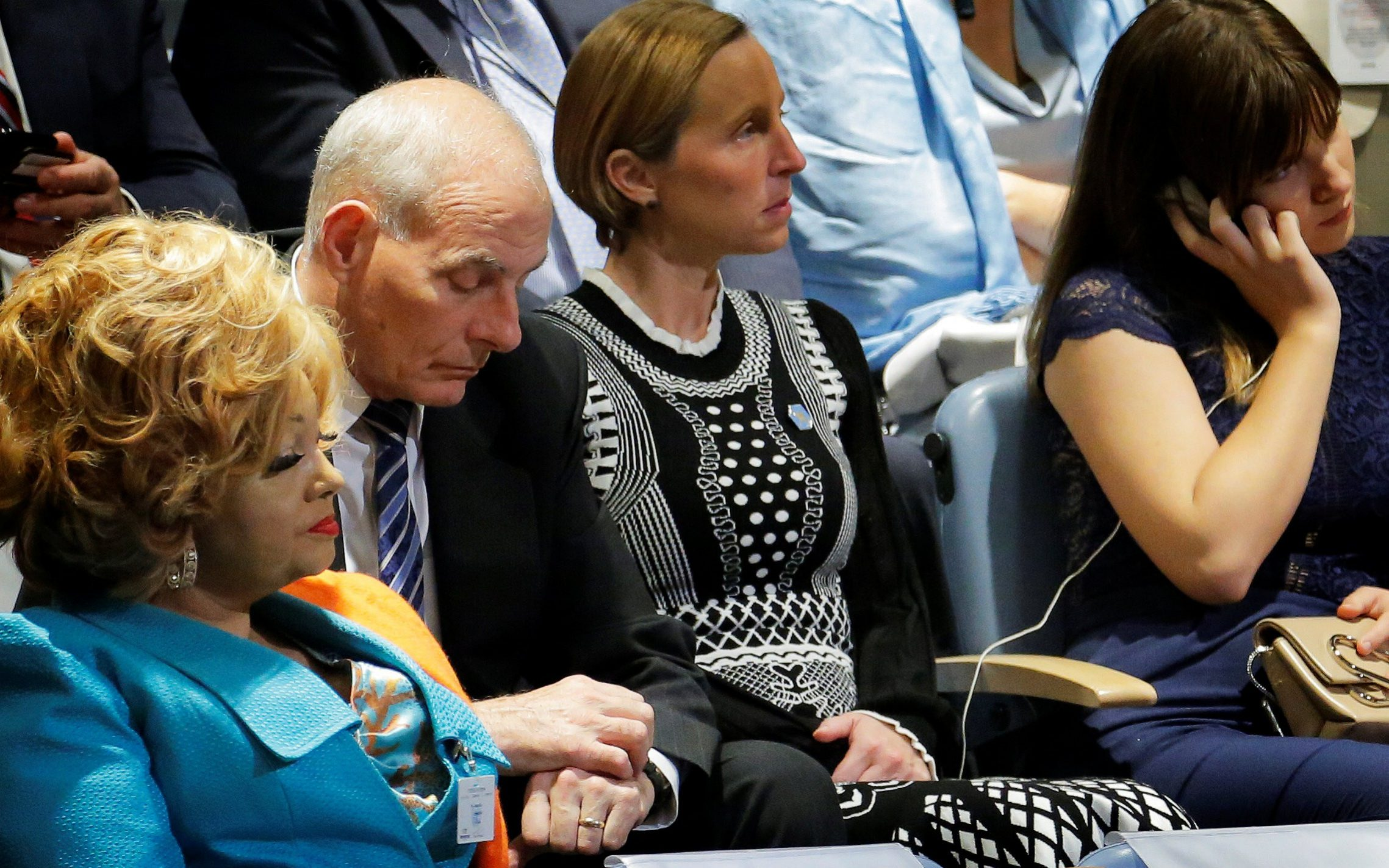 White House Chief of Staff Kelly checks his watch as he listens to U.S. President Trump deliver his address to the UN