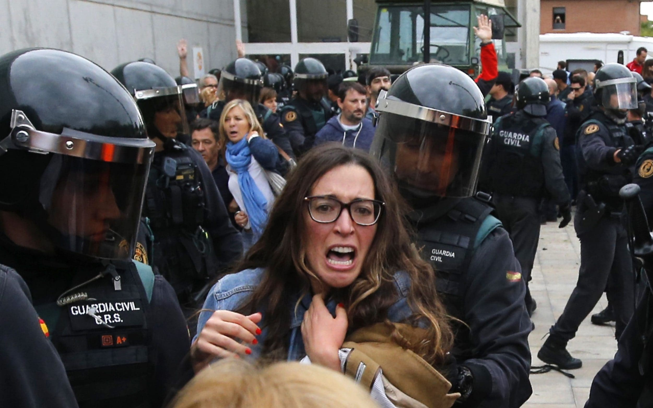 People clash with Spanish Guardia Civil guards