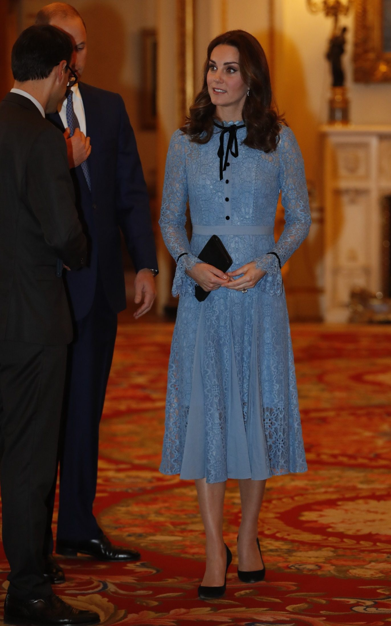 The Duchess' dress included black detailing, such as five buttons and a bow round the neckline