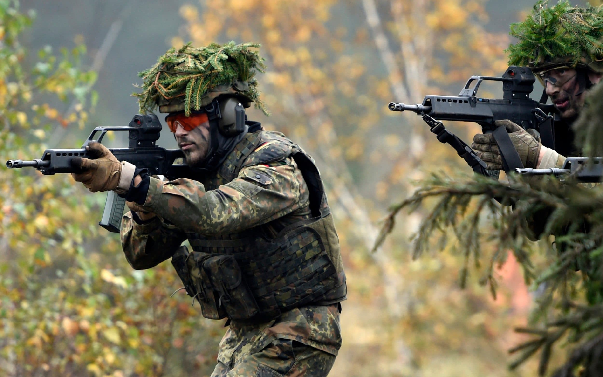 Armored infantryman of the Bundeswehr, the German armed forces, during a simulated attack as part of military exercises