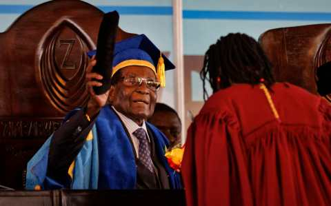 Zimbabwe's President Robert Mugabe confers awards for the students with the leading theses, as he presides over a graduation ceremony at Zimbabwe Open University on the outskirts of Harare