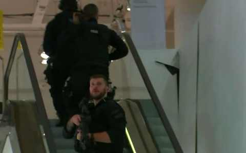 Armed police patrol a department store, near to Oxford Street