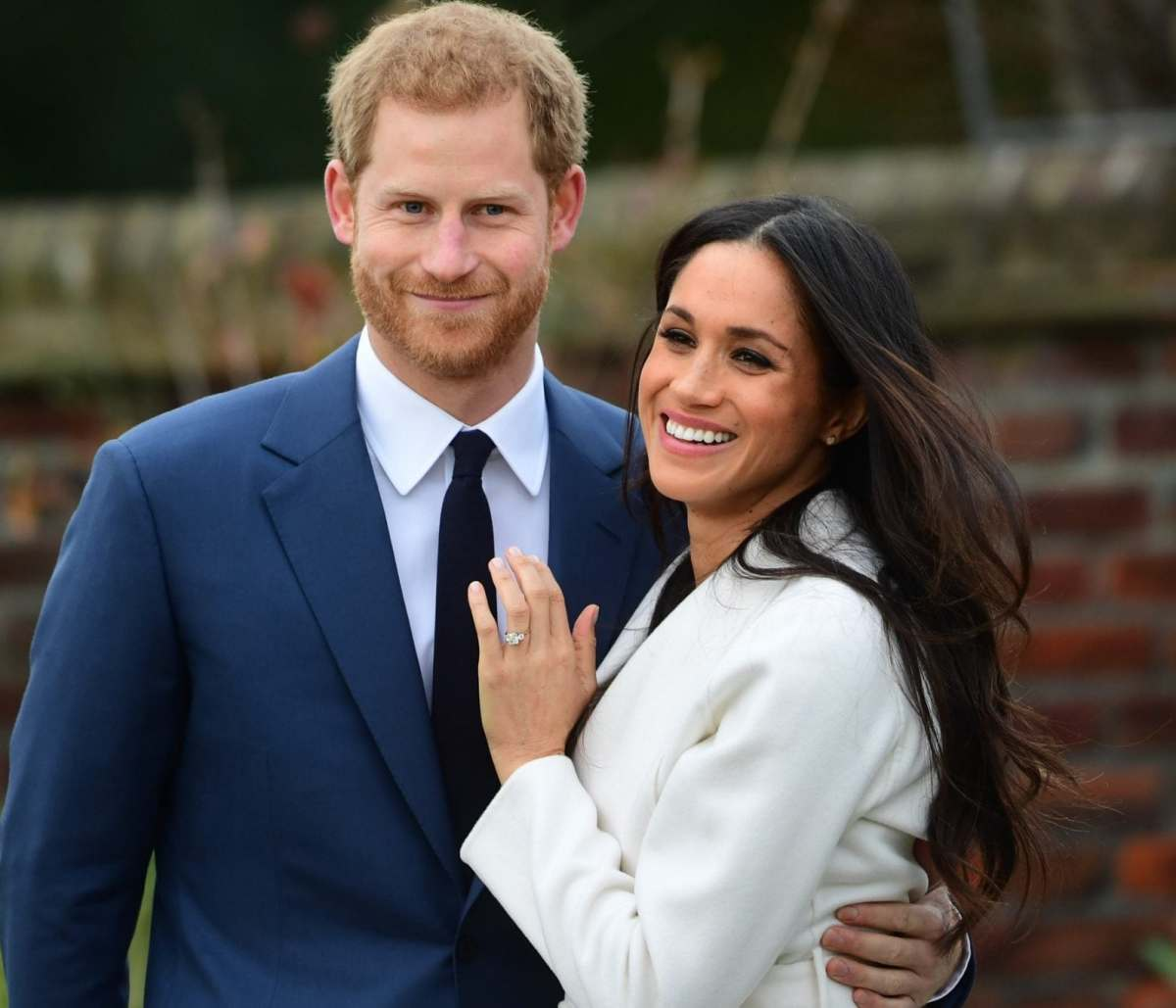 Meghan Markle shows off her wedding ring as she poses with Prince Harry in Kensington Palace
