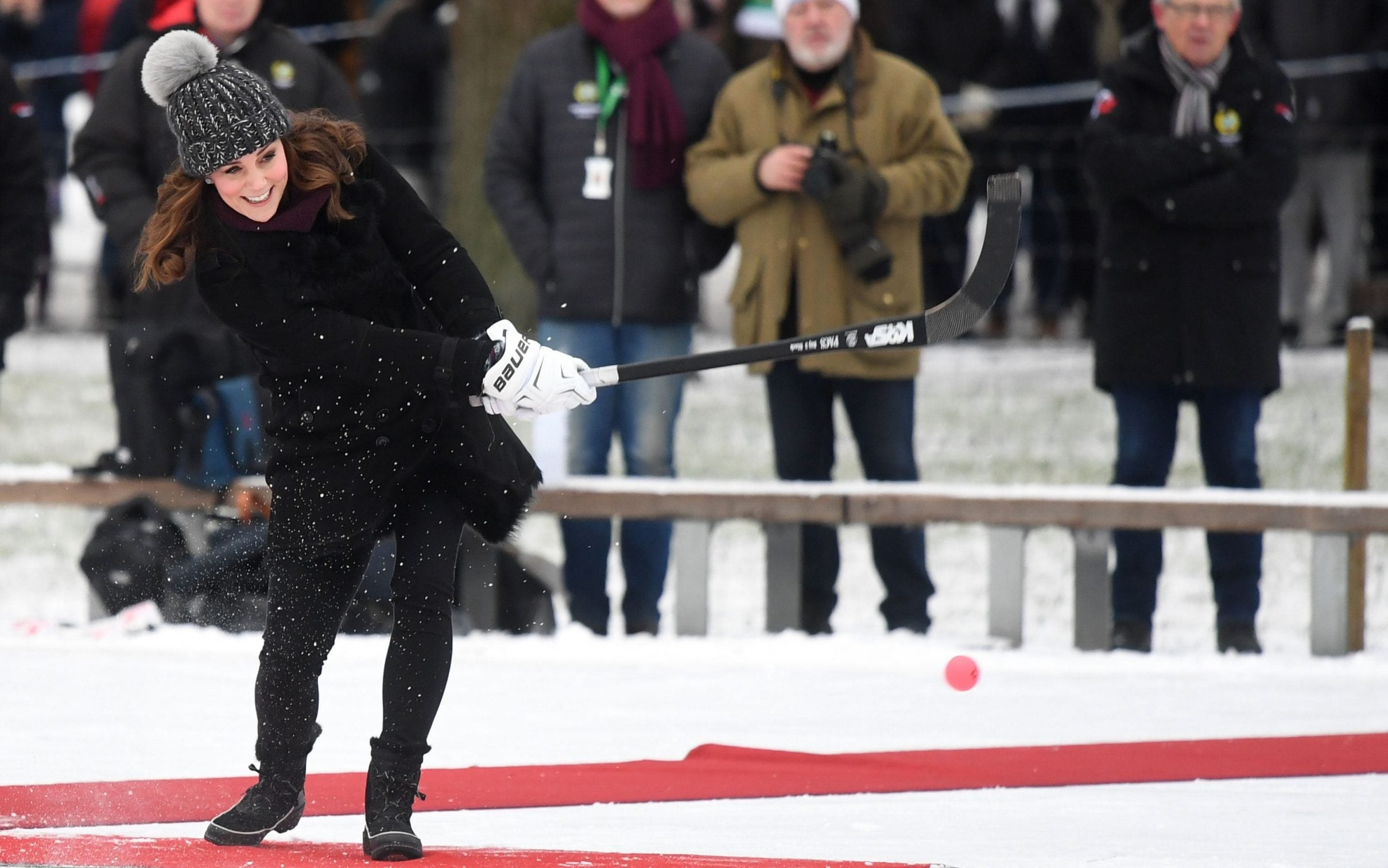 Duchess of Cambridge hits a hockey ball
