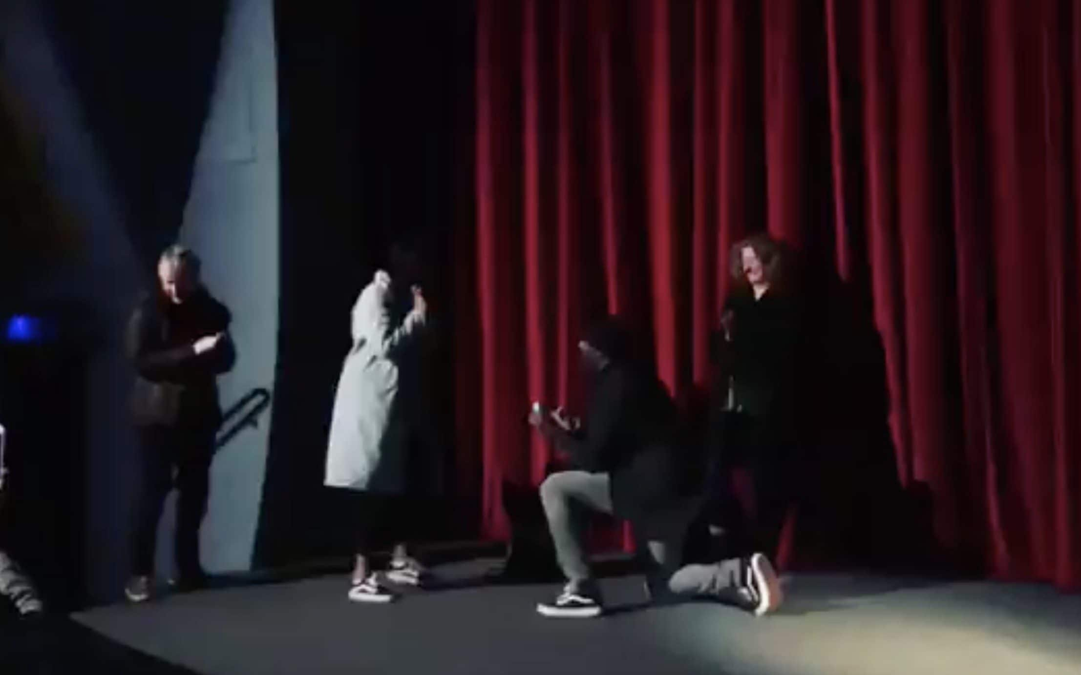 Idris Elba down on one knee, proposing to his girlfriend Sabrina Dhowre on the stage of the Rio cinema, in Dalston