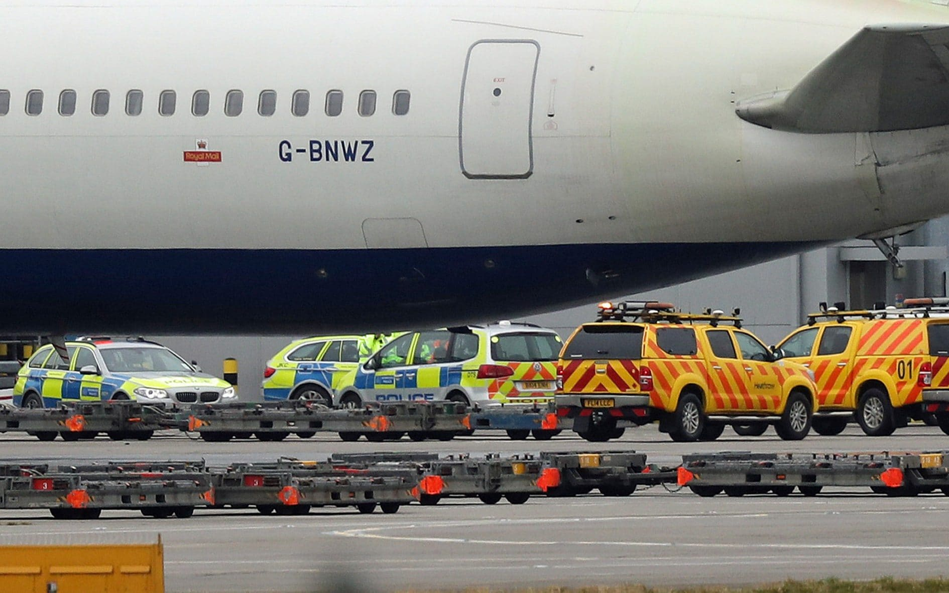Police and airside operations vehicles at Heathrow Airport where a man, aged in his 40s, died after two airport vehicles crashed on the airfield