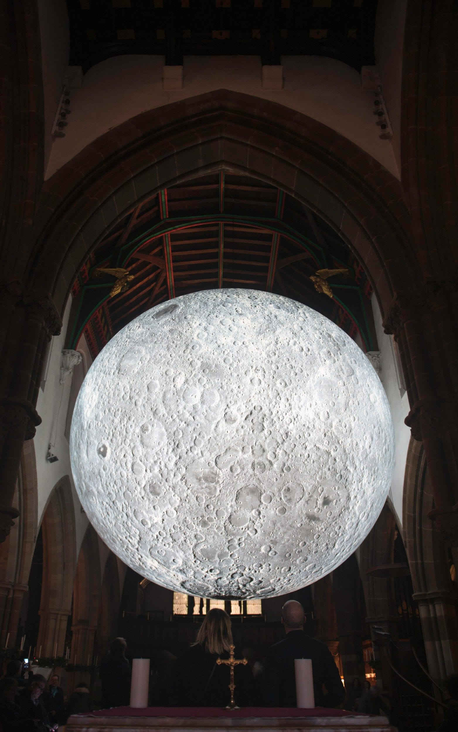 A Giant Moon Sculpture Is Suspended In The Nave Of