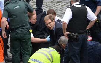 Tobias Ellwood says public should 'step forward' suggesting he is at odds  with Government terror advice
