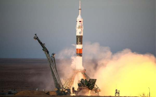 Astronauts blast off for space station on Russian rocket ...