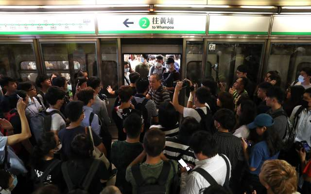Activists blocked train doors, playing havoc with services