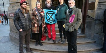 Extinction Rebellion activists cleared after arresting officer books holiday during trial