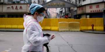 Wuhan residents told to stay inside and stay vigilant as China begins to lift virus lockdown