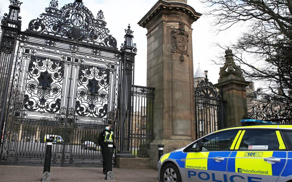 Police outside the Palace of Holyroodhouse in Edinburgh
