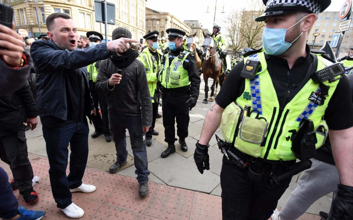 Protesters shout at police during the anti-lockdown demonstration