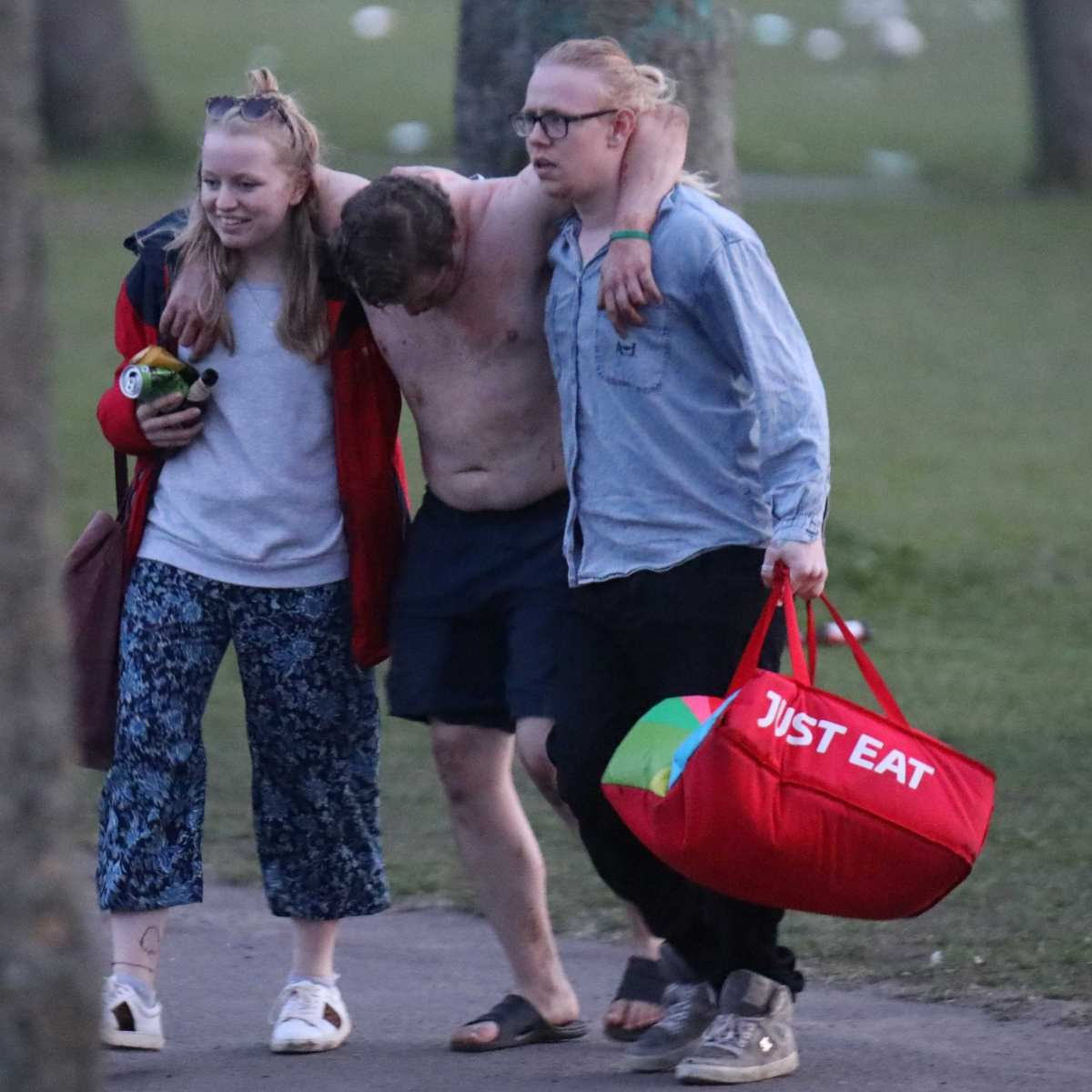 A man is helped away from Hyde Park