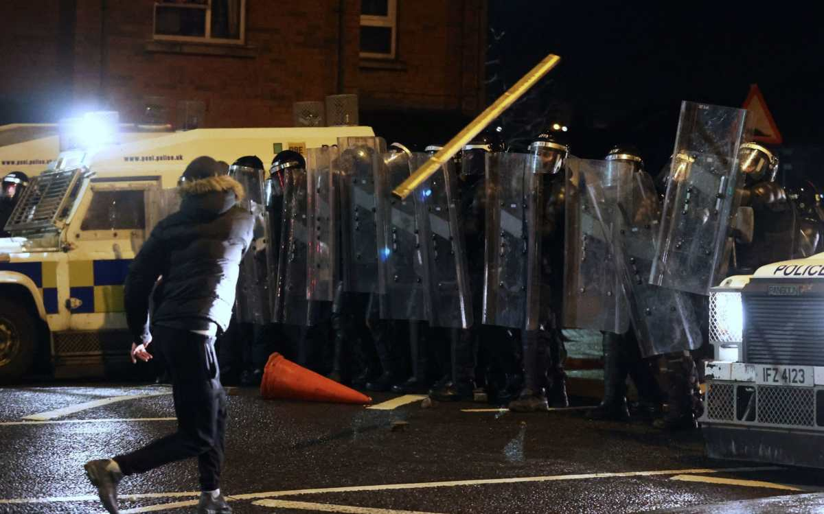 Police in riot gear had objects thrown at them by protesters