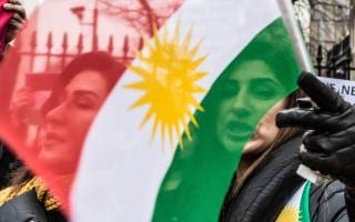 Image result for Masoud Barzani, photos, marching, with Kurdish flag
