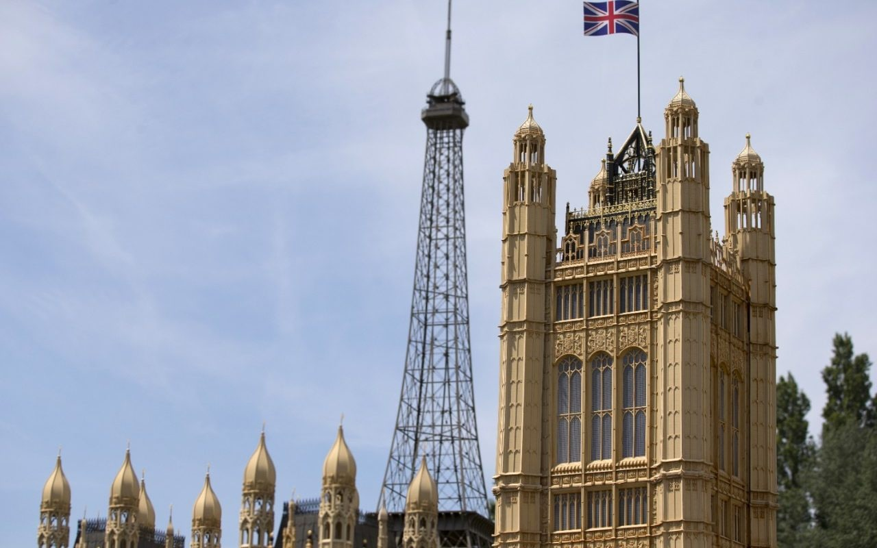 A British Union flag sits on top of a scale model of the British Houses of Parliament as a model of the Eiffel Tower stands behind, at the Mini Europe theme park, in Brussels, Belgium