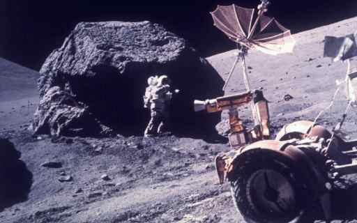 Harrison Jack Schmitt taking samples from a boulder which never saw sunlight