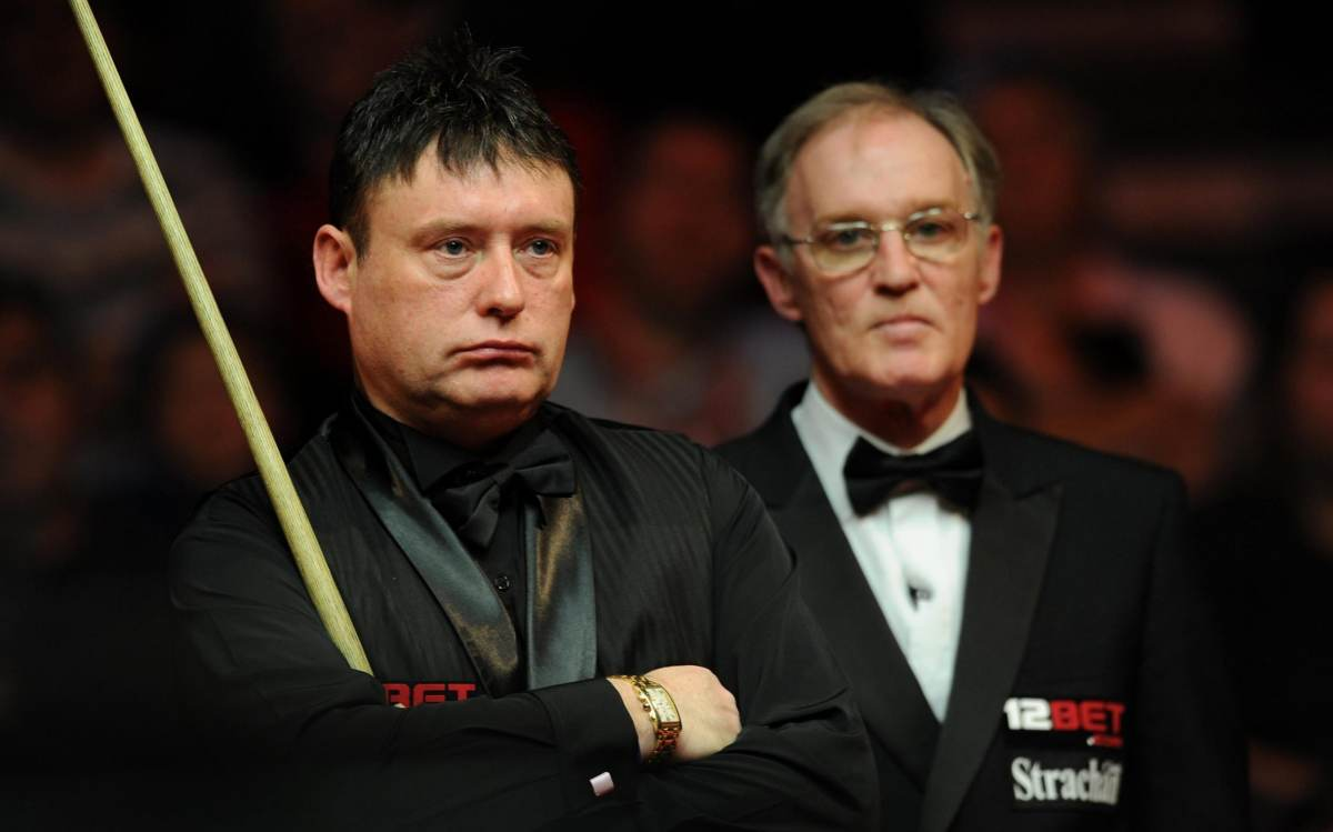 England's Jimmy White (left) during his match against Scotland's Stephen Hendry during the 12Bet.Com UK Championships at the Telford International Centre, Telford.