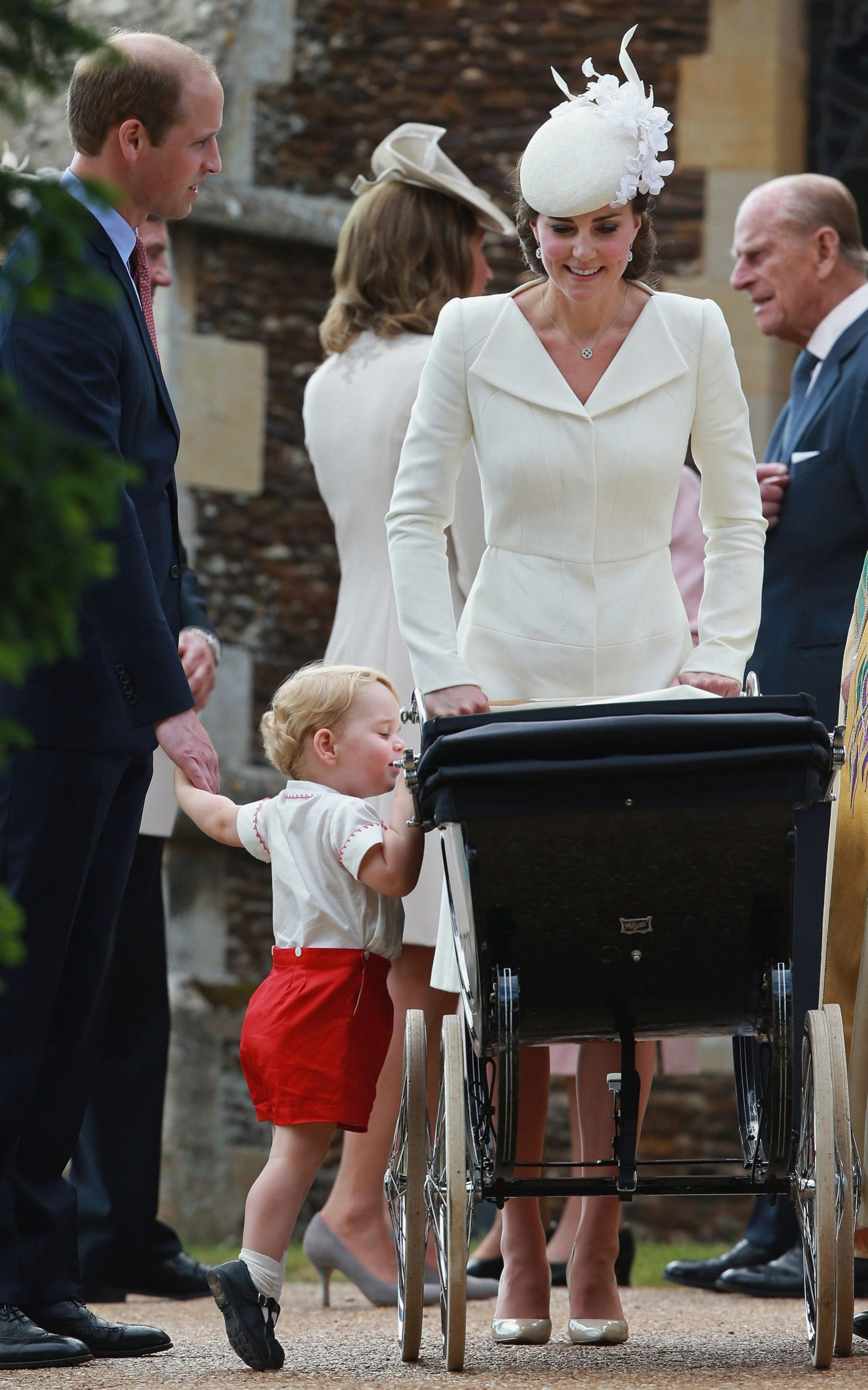 Prince George peeking into his sister's vintage Millson Prince pram at her christening