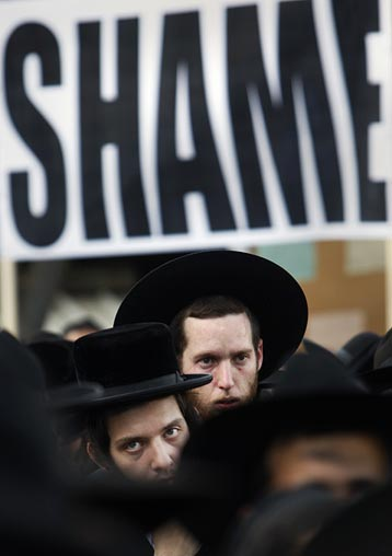 Ultra-Orthodox Jews demonstrate against a gay pride parade