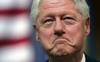 Bill Clinton; Bill Clinton says Barack Obama must 'kiss my ass' for his support