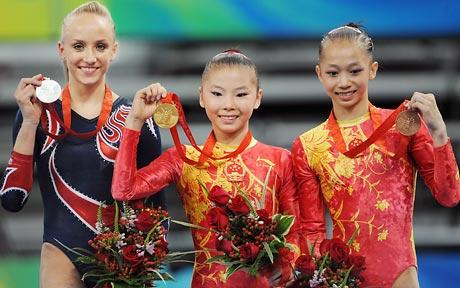 He Kexin, Nastia Liukin and Yang Yilin on the medal stand in Beijing.