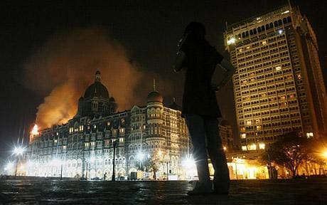 The Taj Mahal Palace Hotel, ablaze (Reuters)