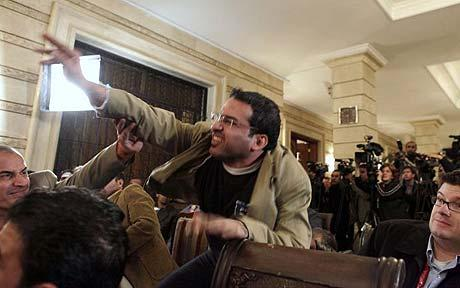 An Iraqi journalist throws a shoe at President George W. Bush during a news conference