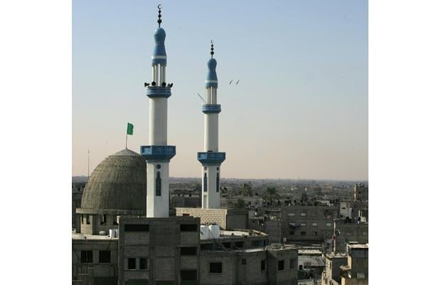 Bombs drop behind a mosque during an Israeli air strike in the southern Gaza Strip town of Rafah near the border with Egypt...