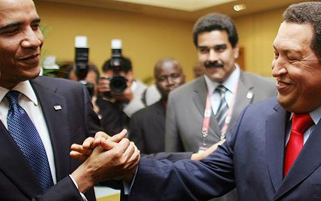 President Obama shakes hands with Hugo Chavez