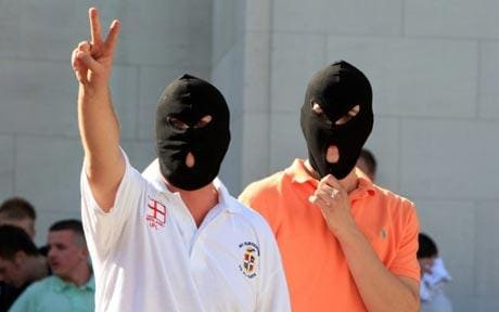 Two men wearing balaclavas during the protest
