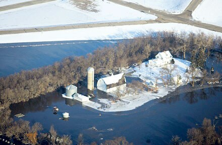 Waterworld: Vehicle parked in the floodwater surrounding a farm near Fargo, North Dakota, in March 2009