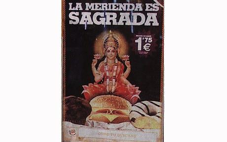 The advertisement shows a picture of Lakshmi, the Indian goddess of wealth, about to eat one of the beef burgers, which are forbidden under Hindu religion  Photo: EUROPICS