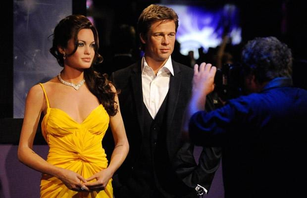 Waxworks of actors Angelina Jolie and Brad Pitt are photographed at the opening of Madame Tussauds Hollywood