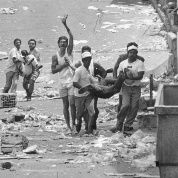Victims of the wave of state violence unleashed during the Caracazo run in the streets.