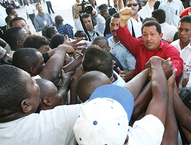 Chavez is greeted by dozens in Haitians upon his arrival in 2007. Venezuela was one of the most generous nations to Haiti following the devastating 2010 earthquake, forgiving hundreds of millions in debt.