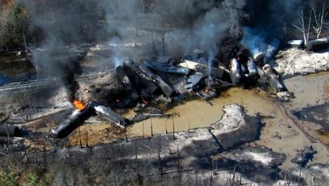Smoke rises from derailed train cars in western Alabama on Nov. 8, 2013.