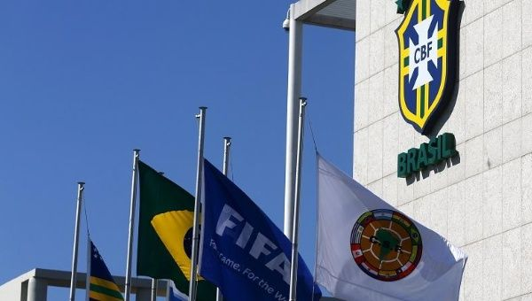 Flags of FIFA (2nd R) and Conmebol (R) are pictured outside the Brazilian Football Confederation (CBF) headquarters in Rio de Janeiro, Brazil May 28, 2015.