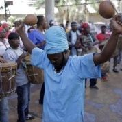 Members of the Garifuna organization OFRANEH demonstrate in front of the Honduran Parliament in Tegucigalpa.